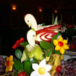 Two Swans and Flowers - Apple Fruit Art in Houston