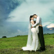 Couple at Outdoor Wedding (Grass & Clouds)