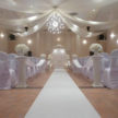 All White Indoor Wedding Ceremony Site