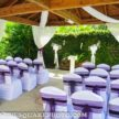 Outdoor Ceremony for Spring Wedding under Poolside Gazebo at Demers Banquet Hall
